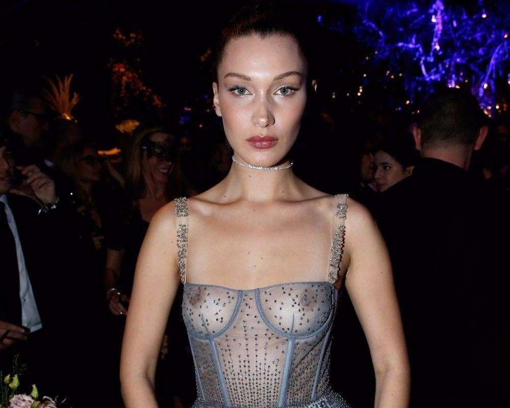 bella hadid puts her tits on display in a see thru dress