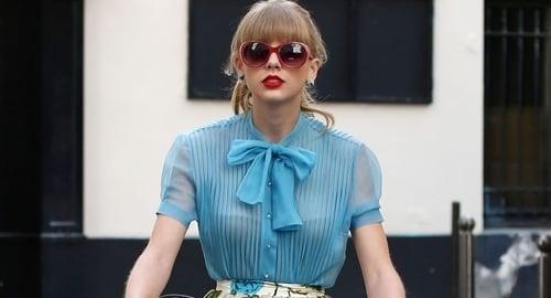 Taylor Swift Traipses Around Showing Her Bra