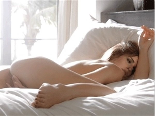 Sexy blonde babe masturbating naked on the bed