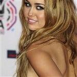 Miley Cyrus Shows Under Boob Tat