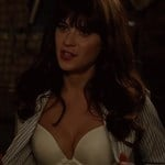 Zooey Deschanel Unbuttons Her Shirt To Show Her Bra