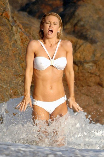 kelly carlson plays in the ocean like a whore