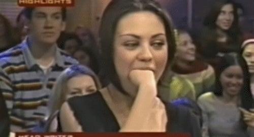 Mila Kunis fist