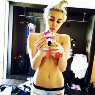 Miley Cyrus Posts Topless Selfie After Oral