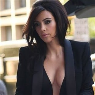 Kim Kardashian Investigated For Child Abuse After Braless Outing