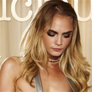 Cara Delevingne Gets Naked And Shares Her Favorite Holiday Tradition