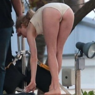Amanda Seyfried Bends Over In A Thong Swimsuit